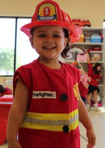 Preschooler dressed as firefighter