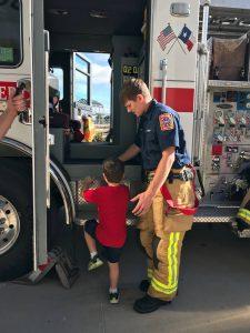 Emergency responder helping preschooler