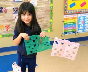 child making papel picado