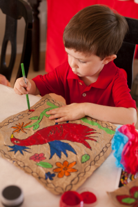 child making amate, child making mexican paper craft