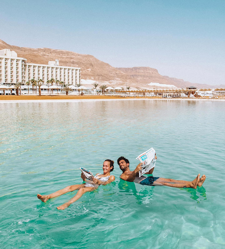 Couple floating in the salty Dead Sea